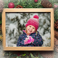 Photo effect - Photo frame with Christmas decorations from pine cones