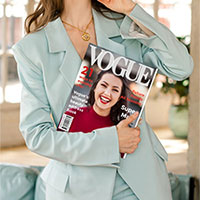 Photo effect - Woman holding Vogue magazine