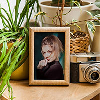 Effect - Wooden photo frame on the wooden table