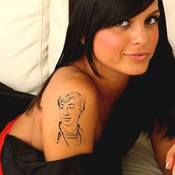Photo effect - Tattoo on the arm of charming girl
