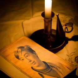 Photo effect - Reading old book by candlelight