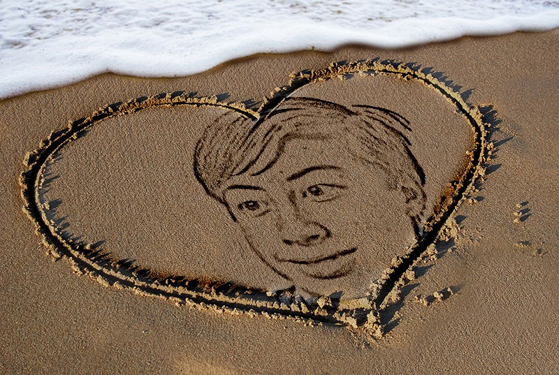 Photo effect - Heart drawn on the sand
