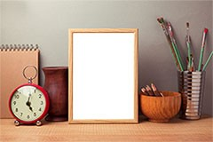 Wooden photo frame on the table
